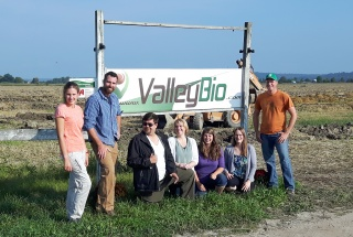 Part of the Valley Bio team poses in front of the company's sign