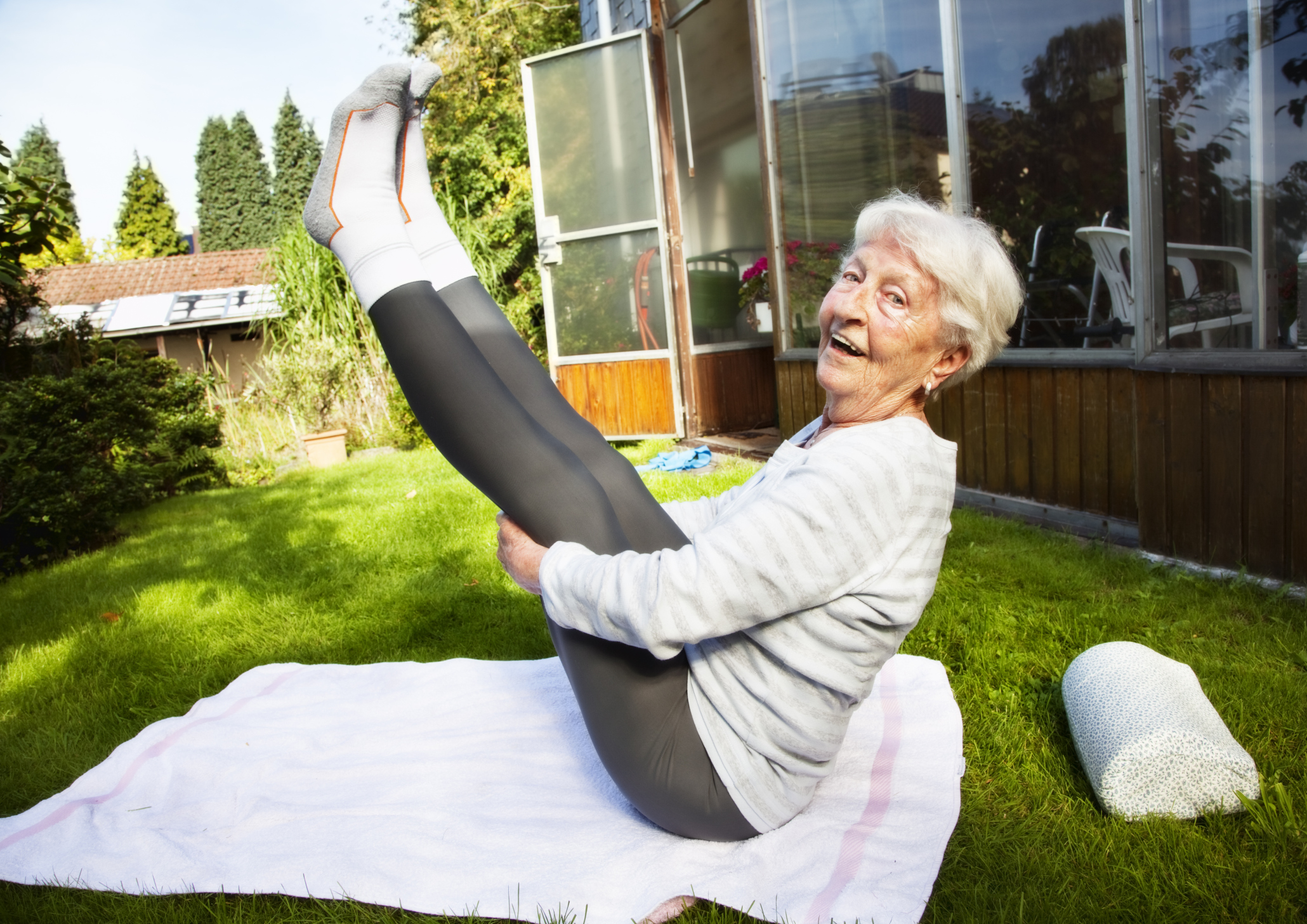 Image of an elderly woman doing yoga