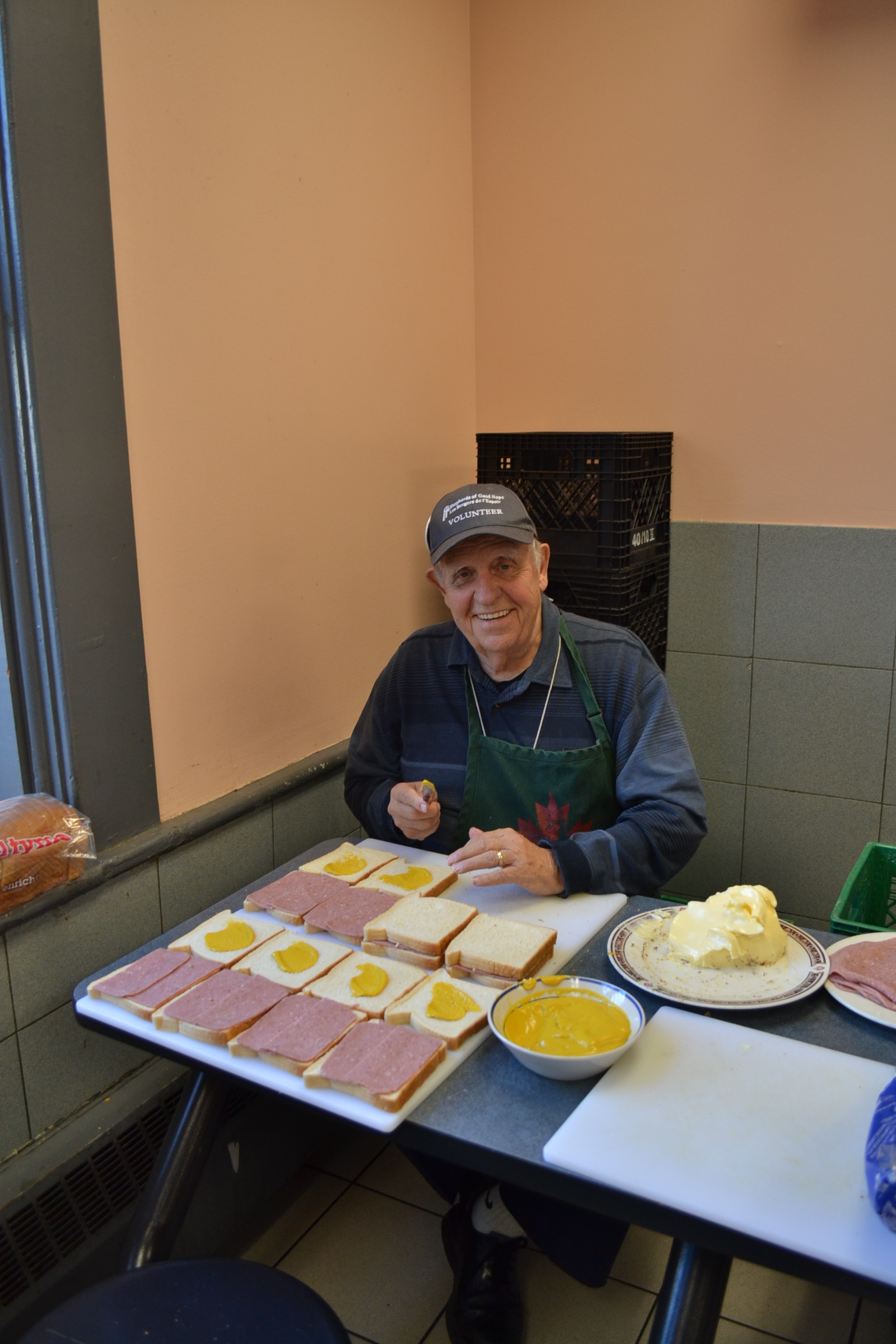 Image of man making sandwiches
