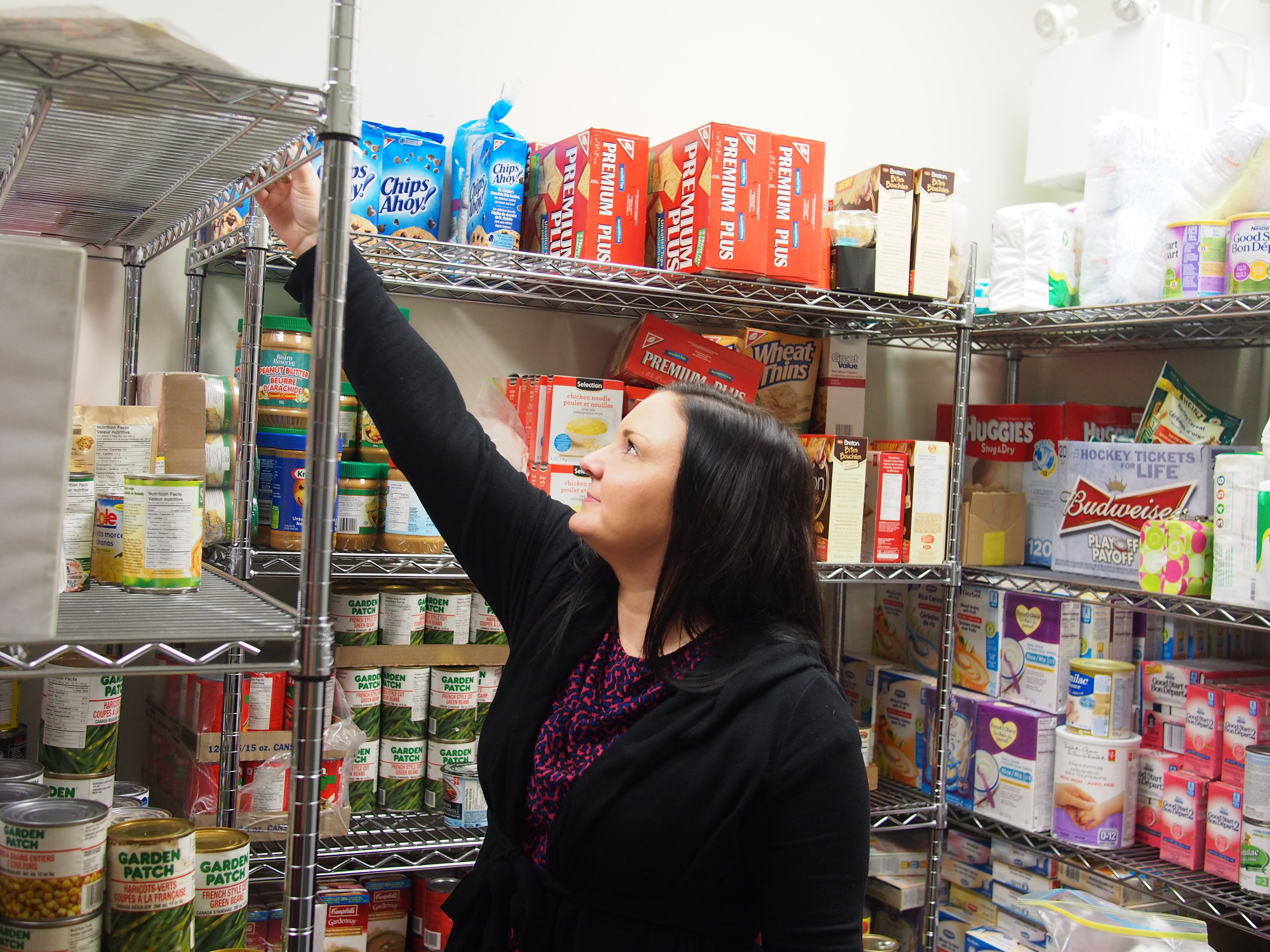 Image of a young woman in a pantry