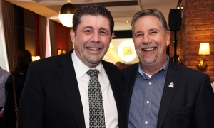 From left, Bruno Beaudoin, general manager of Novotel Ottawa, with Steve Ball, president of the Ottawa Gatineau Hotel Association, at the grand opening party for The Albion Rooms' new Heritage Room Gastropub located at the downtown hotel. (Photo by Caroline Phillips)