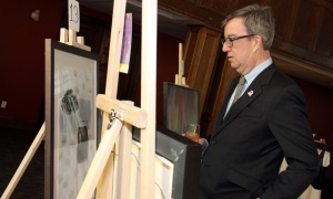 Mayor Jim Watson checks out the artwork during the Big Art Come Back fundraiser for Big Brothers Big Sisters of Ottawa and Operation Come Home, held at the Glebe Community Centre on Saturday, March 25, 2017. (Photo by Caroline Phillips)