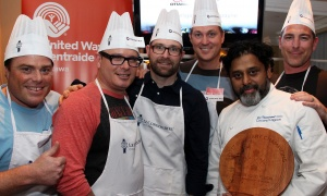 From left, Gowling WLG law partner Marc Richard and his colleagues Hans Schroeder, Michael O'Neill, Michael Crichton, Coconut Lagoon chef/owner Joe Thottungal, and James Baker, also with Gowling WLG, won the inaugural Food Fusion cooking competition held at Le Cordon Bleu on Thursday, March 30, 2017 in support of United Way Ottawa. (Photo by Caroline Phillips)