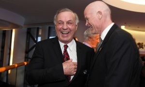 Hockey legend Guy Lafleur, left, shares a laugh with retired NHL player Jim Kyte, now the dean of Algonquin College's School of Hospitality and Tourism, at the Canadian Museum of History on Wednesday, March 15, 2017, for the Stanley Cup 125th Evening Celebration. (Photo by Caroline Phillips)