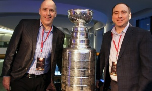 From left, Kevin O'Shea, division president at Mattamy Homes, and Ray Charron, vice-president of finance at Mattamy Homes, pose with the Stanley Cup during at VIP reception held  at the Canadian Museum of History on Wednesday, March 15, 2017, for the Stanley Cup 125th Evening Celebration. (Photo by Caroline Phillips)
