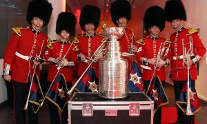 The Governor General's Foot Guards took a quick break from their duties to pose with the Stanley Cup  at the Canadian Museum of History on Wednesday, March 15, 2017, for the Stanley Cup 125th Evening Celebration. (Photo by Caroline Phillips)