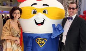 The gala mascot at the Sparkle Dental Charity Gala, held at the Infinity Convention Centre on Saturday, April 29, 201, was a hit with Ottawa dentist Marina Polonsky and Ian Murray. (Photo by Caroline Phillips)