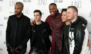 Canadian rapper Kardinal Offishall, centre, joined by members of the Canadian band Neon Dreams on the red carpet at the JunoGala Dinner and Awards held at the Shaw Centre on Saturday, April 1, 2017. (Photo by Caroline Phillips)