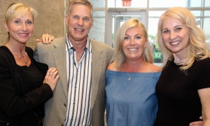 From left, Karen Zanet-deGruchy, CEO of Ottawa Health Group, with her husband, Dr. Mark deGruchy, chiropractor for the Ottawa Redblacks, Vanessa Richardson and Colleen McBride-O'Brien at a tailgate party hosted by the football team's president on Friday, June 23, 2017, in support of the IBD Centre at CHEO. (Photo by Caroline Phillips)