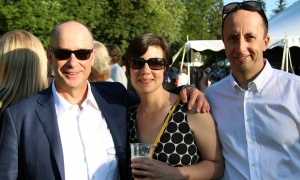 From left, Paul Genest, senior vice president of Power Corporation of Canada, with Frédérique Tsai-Klassen, owner off Das Lokal Kitchen and Bar on Dalhousie Street, and Steven Hogue, associate director of federal relations at Pfizer Canada, at the U.S. Embassy's Fourth of July celebration, held Tuesday, July 4, 2017. (Photo by Caroline Phillips)
