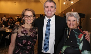 From left, Lisa Davey, executive director of the OutCare Foundation, with past board chair John Bradley and current chair, Sharon Carstairs,  at Black Tie Bingo, held at the Ottawa Conference and Event Centre on Saturday, November 18, 2017. Photo by Caroline Phillips