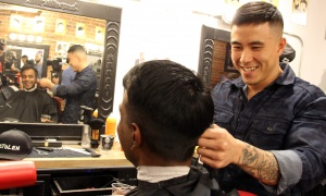 Sanjeev Manickam gets a cut from David Lu at the Capital Barber Shop in the Glebe as part of  the Movember Ottawa kick-off held Wednesday, November 1, 2017. Photo by Caroline Phillips