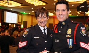 Sgts. Stephanie Andrascik and Sebastien Paradis were among the members of the Ottawa Police Service who volunteered at the Christmas Cheer Breakfast, selling raffle tickets. Photo by Caroline Phillips