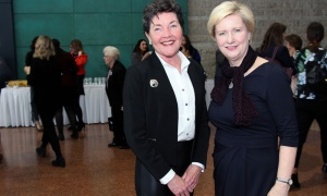 From left, retired high-tech executive Fiona Gilfillan with Chris Kincaid, co-owner of Mediaplus Advertising, at the International Women's Day breakfast reception hosted by Mayor Jim Watson at Ottawa City Hall. Photo by Caroline Phillips