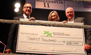 From left, Steve Gallant, Colleen Mooney and Grant Cobb, senior vice president with Cara Operations, during a ceremonial cheque presentation at Ringside for Youth XXIV. Photo by Caroline Phillips