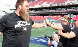 Redblacks offensive lineman Jon Gott greets players at the Redblacks Women's Training Camp, held at TD Place Stadium on Tuesday, June 12, 2018, in support of the OSEG Foundation. Photo by Caroline Phillips
