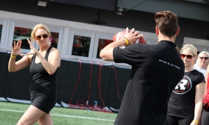Ottawa Redblacks player Greg Ellingson gives instructions on how to properly throw a football at the Redblacks Women's Training Camp, held in support of the OSEG Foundation. Photo by Caroline Phillips
