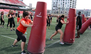 Participants of the Redblacks Women's Training Camp, held at TD Place at Lansdowne, took part in a series of drills and exercises as part of a fundraiser for Ottawa Sports and Entertainment Group's new charitable foundation. Photo by Caroline Phillips