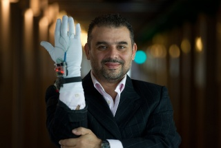 Dr. Abdulmotaleb El Saddik demonstrates a glove-based tool that responds to pressure.